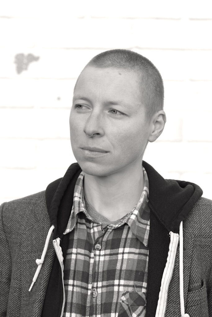A black and white image of a person