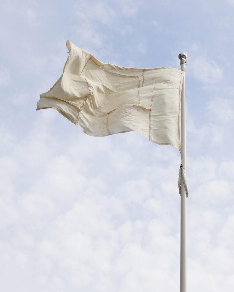A faded flag artwork flying