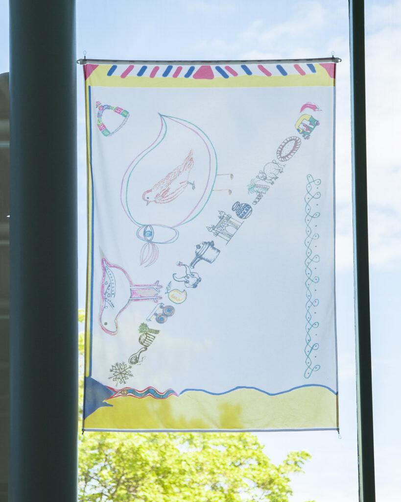 A flag artwork in a window.