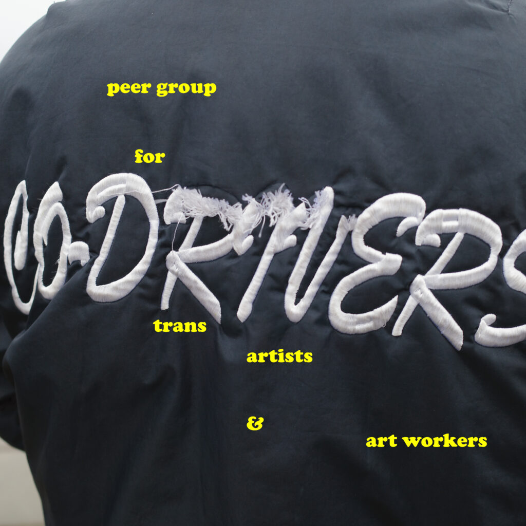 the back of a jacket with text reading co-drivers